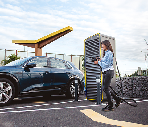 A car that's charging on an electric charging station